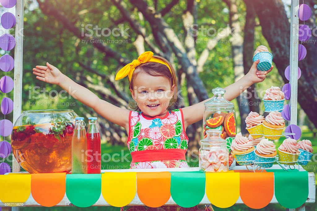 Child behind lemonade stand stock photo