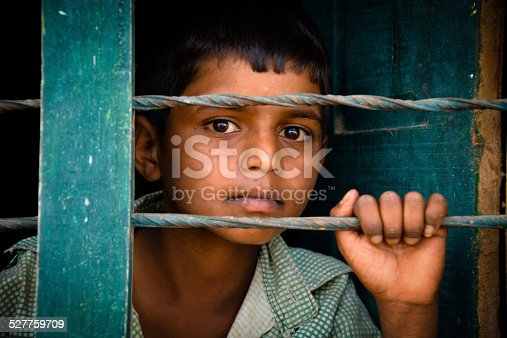 Child behind the bars
