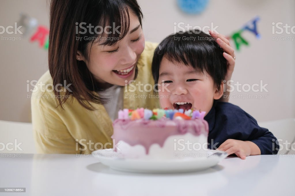 Awesome Child Blowing Out Candles On His Birthday Cake And Making His Wish Birthday Cards Printable Benkemecafe Filternl
