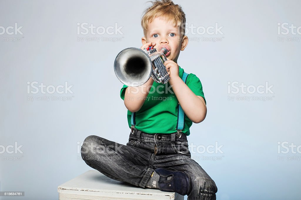 Child Blowing Trumpet stock photo