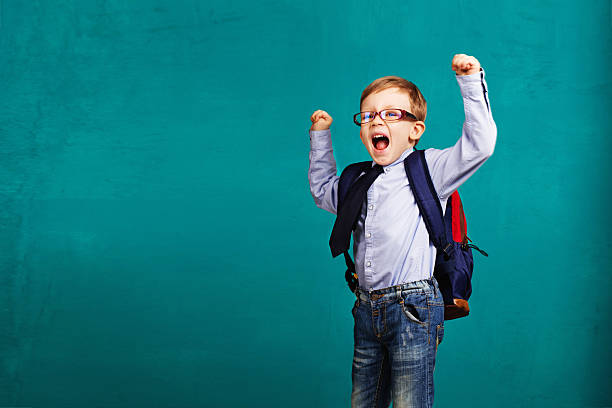 child bouncing into the classroom. stock photo