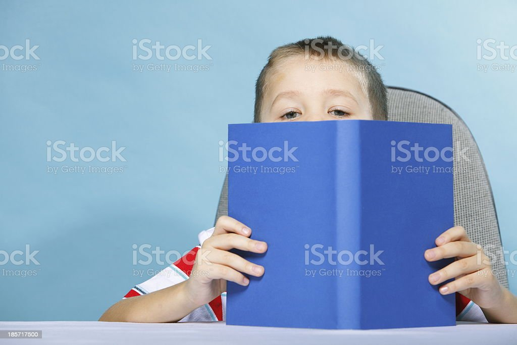 child boy kid reading a book on blue royalty-free stock photo