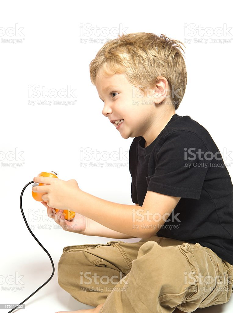 Child Boy Playing A Video Game Stock Photo More Pictures Of 4 5