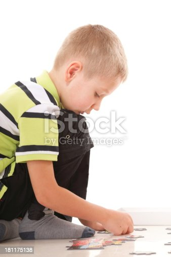 514261930 istock photo child boy playing puzzle isolated 181175138
