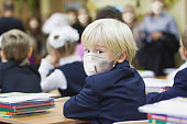 istock Child boy student in protective mask, back to school 1248686560