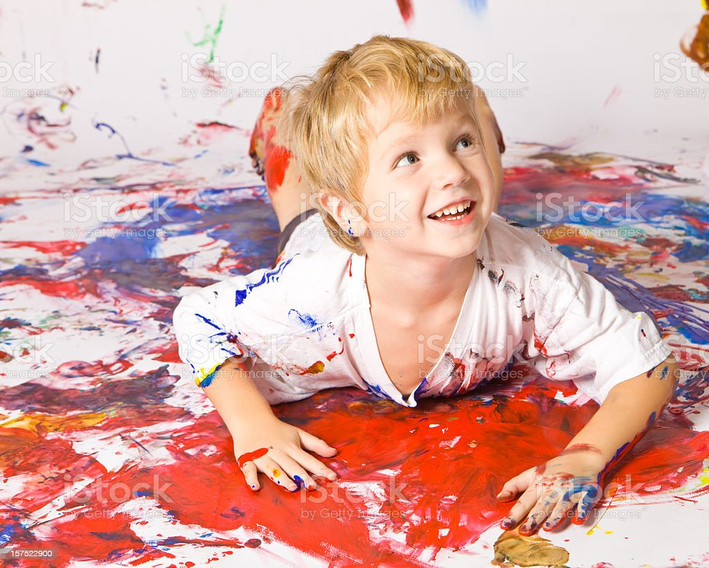 Child Boy Swimming in Paint royalty-free stock photo