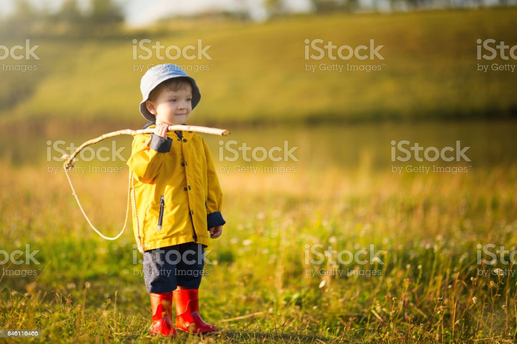 Child boy with fishing rod ready for fishing stock photo