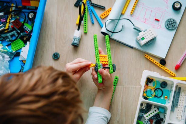 child building robot at robotic technology school lesson stock photo
