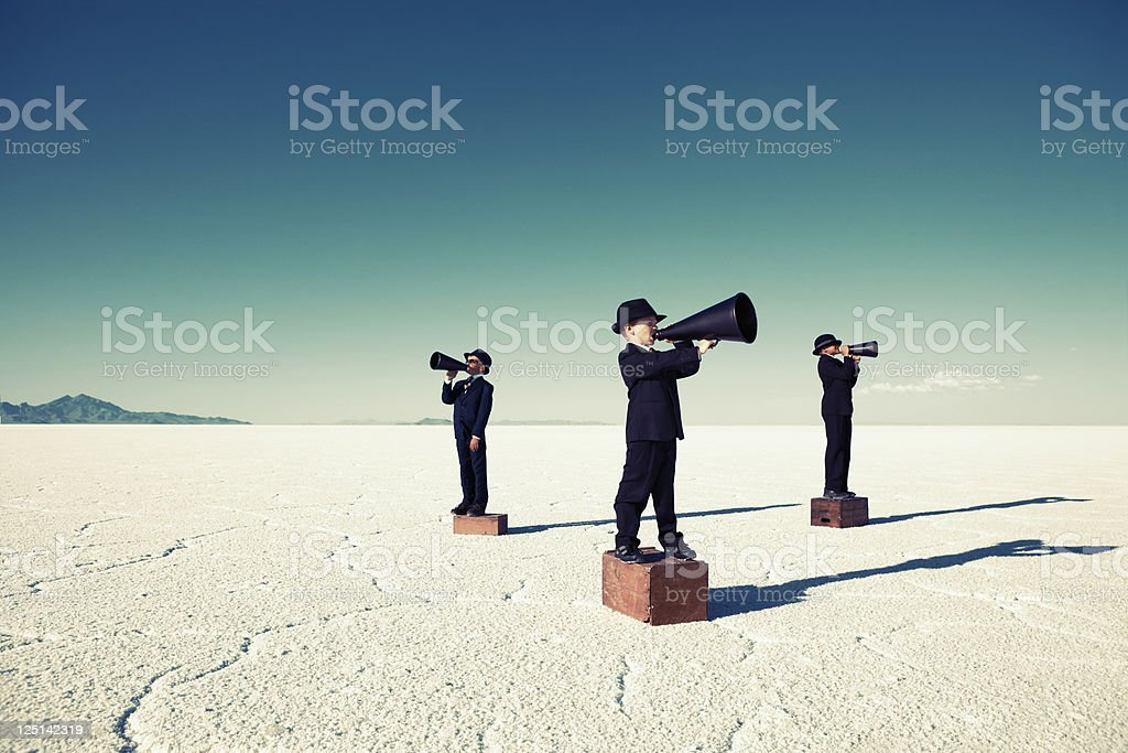 Child Business Team Yell Through Megaphones stock photo