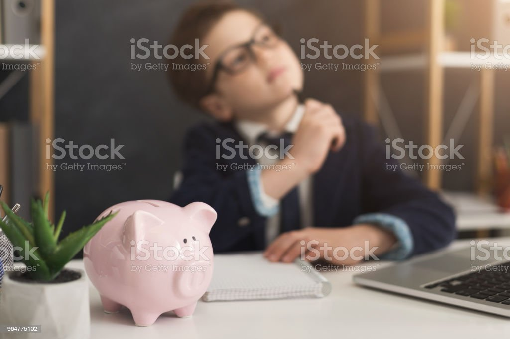 Child businessman dreaming of income royalty-free stock photo