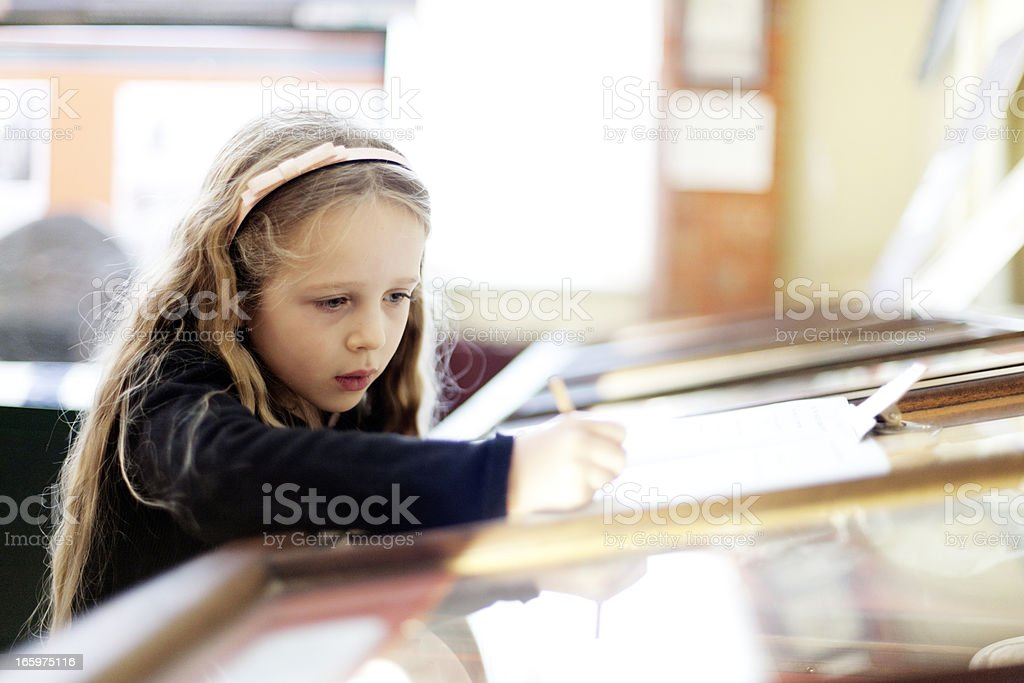 Child by a museum display cabinet royalty-free stock photo