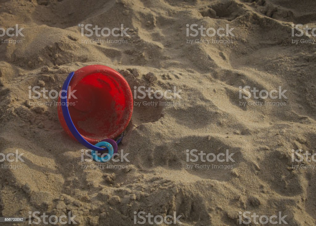 Child Care concept. Toy in a sand pool. stock photo