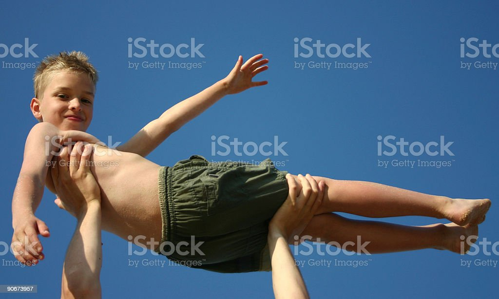 Child carried on hands stock photo
