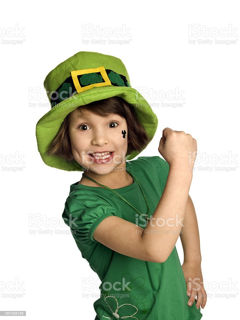Child celebrating and wearing a Saint Patrick's day outfit stock photo