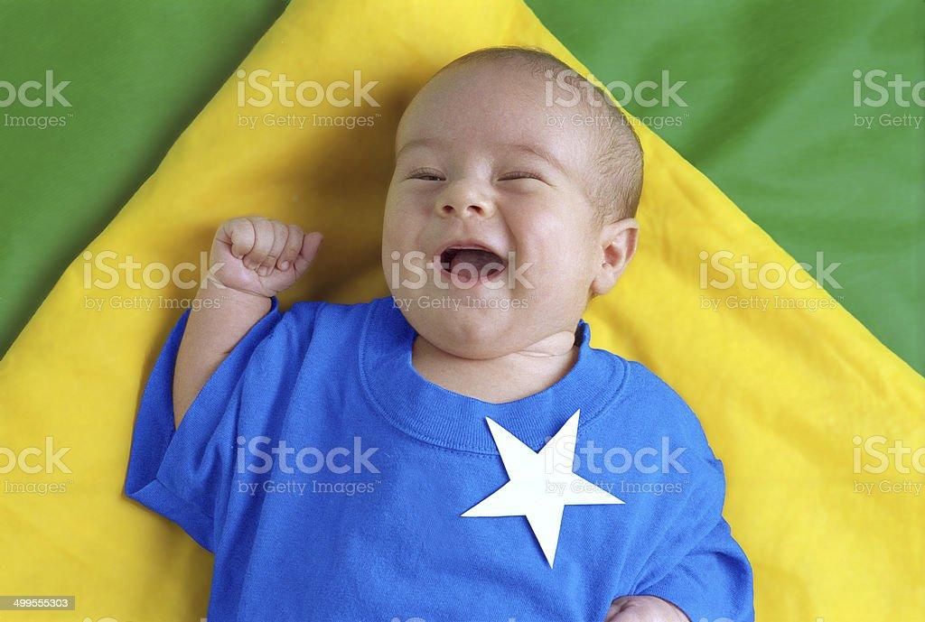 Child celebrating goal on the Brazilian flag. stock photo