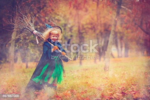 Little girl dressed as witch at Halloween