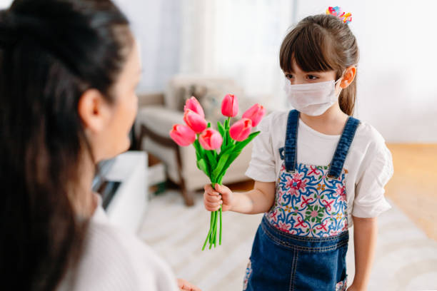child celebrating mother's day at home on quarantine days. - mothers day stock pictures, royalty-free photos & images