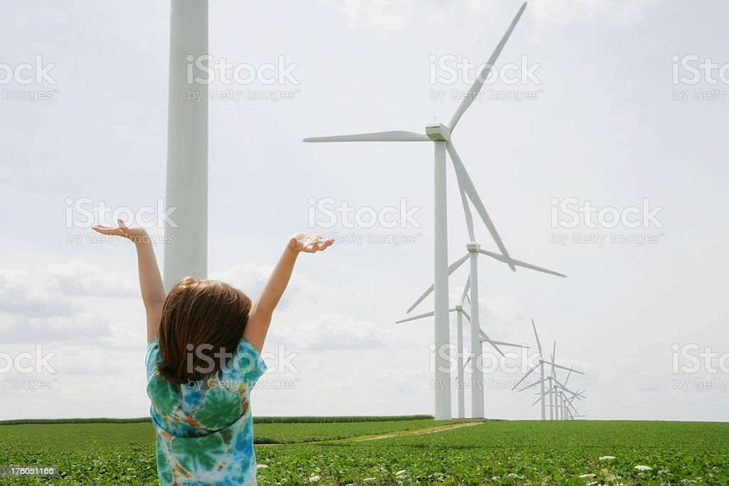 Child Celebrating with Raised Arms Renewable Energy-  Wind Turbines royalty-free stock photo