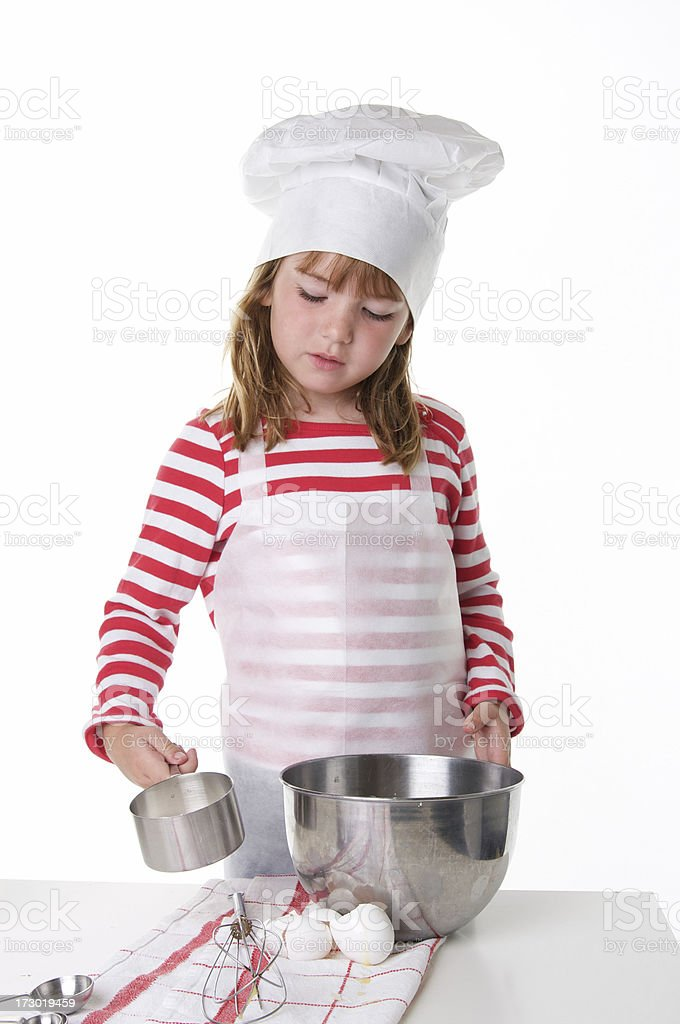 Child Chef With Measuring Cup and Mixing Bowl royalty-free stock photo