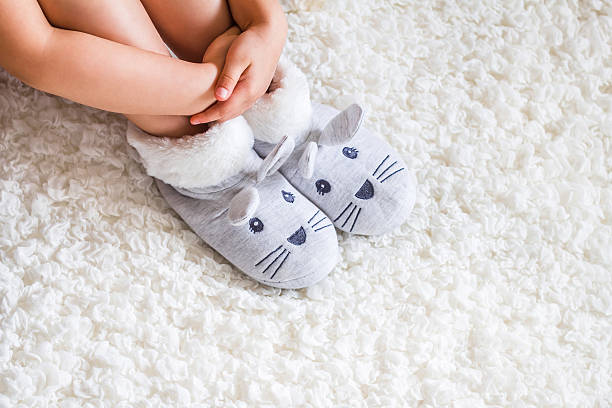 Child. Child's feet in slippers. stock photo