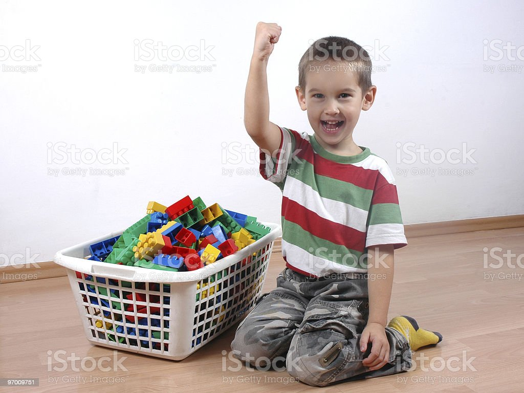 child cleaned the toy blocks stock photo