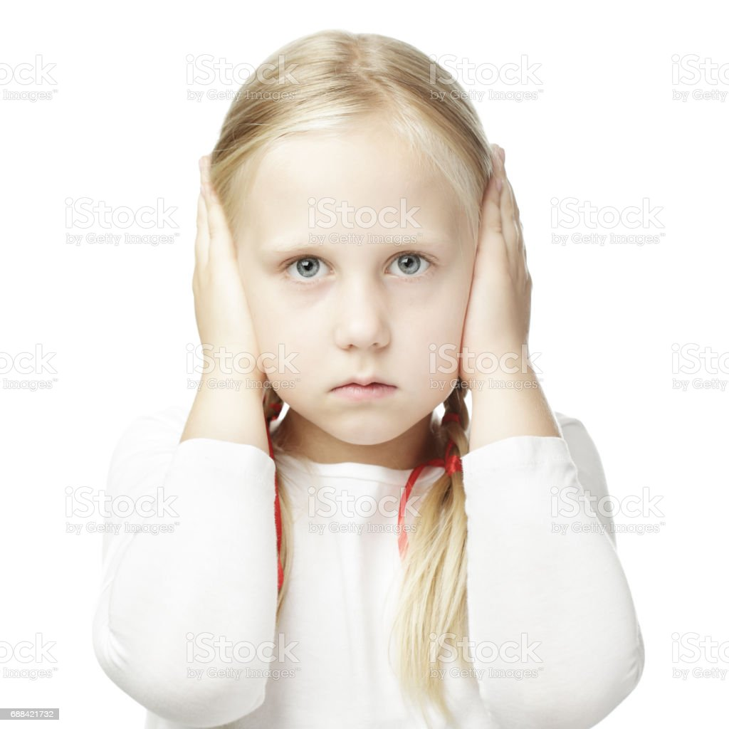 Child closed his hands over his ears and hears nothing stock photo