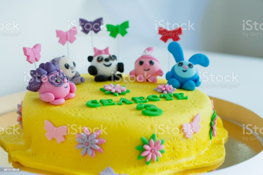 Child Colorful Birthday Cake Decorated With Little Cartoon Characters On The Top Royalty Free