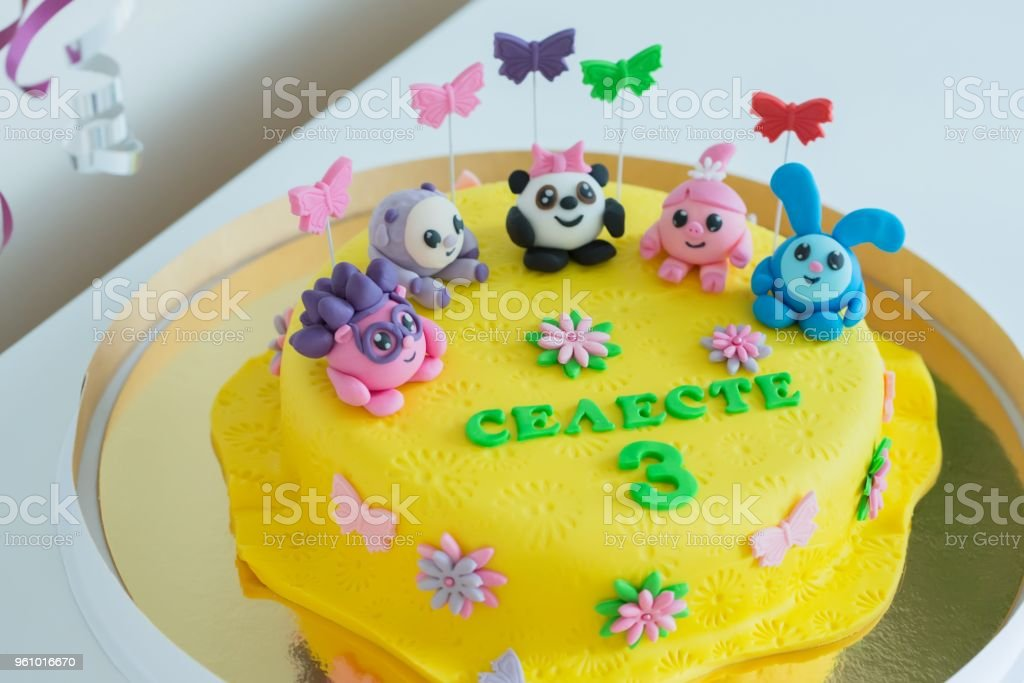 Child Colorful Birthday Cake Decorated With Little Cartoon Characters On The Top