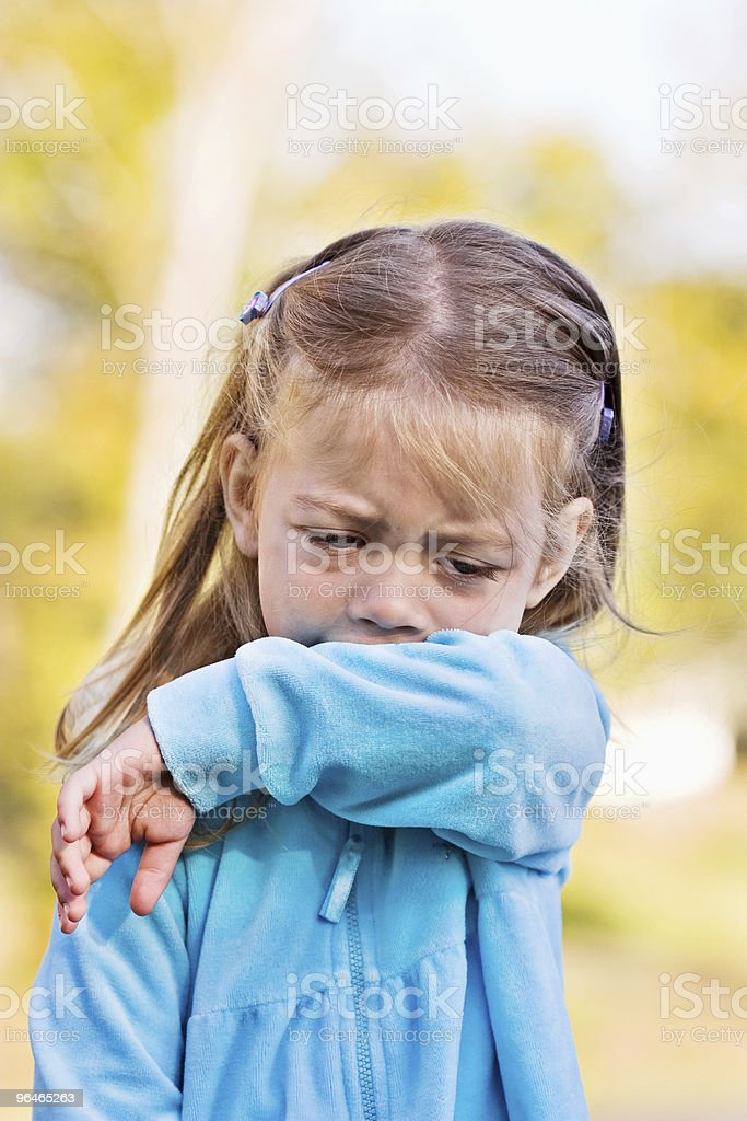 Child Coughing or Sneezing into Elbow royalty-free stock photo