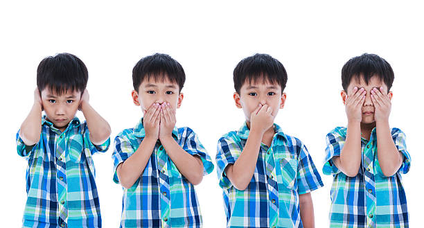 Child covering his ear mouth nose eye in different poses. stock photo