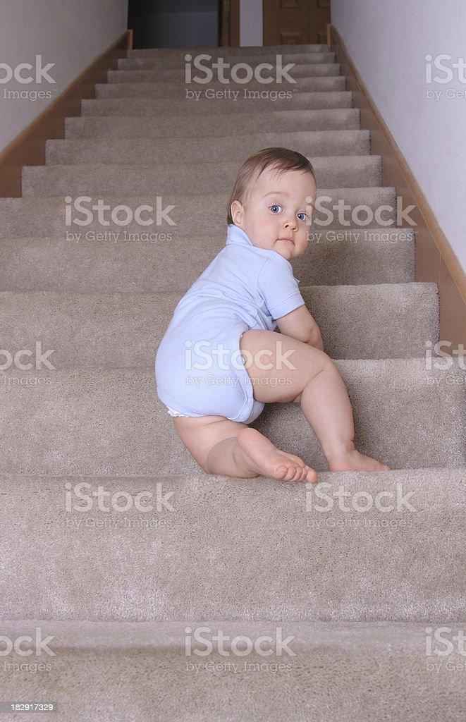 Child Crawling Up Stairs stock photo