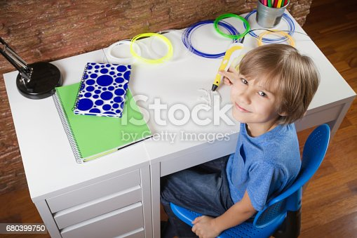 istock Child creating with 3D printing pen. Boy making new item. Creative, technology, leisure, education concept 680399750