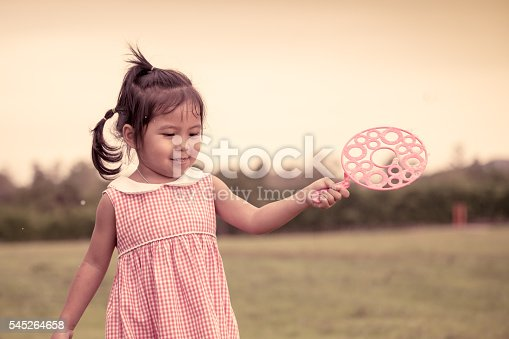507271044istockphoto Child cute little girl having fun to play with toy 545264658