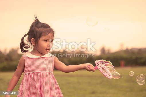 507271044istockphoto Child cute little girl having fun to play with toy 545264910