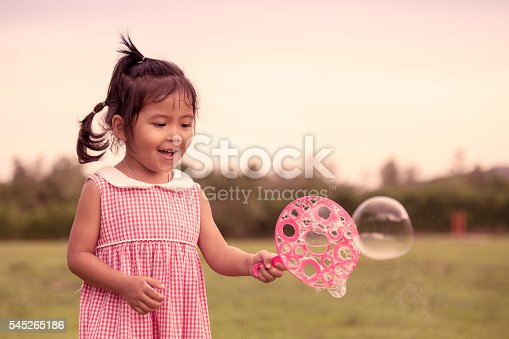 507271044istockphoto Child cute little girl having fun to play with toy 545265186