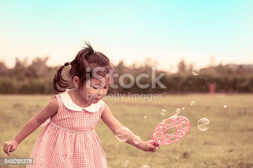 507271044istockphoto Child cute little girl having fun to play with toy 545265378