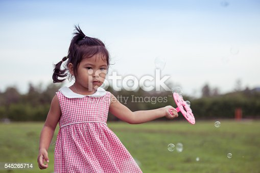 507271044istockphoto Child cute little girl having fun to play with toy 545265714