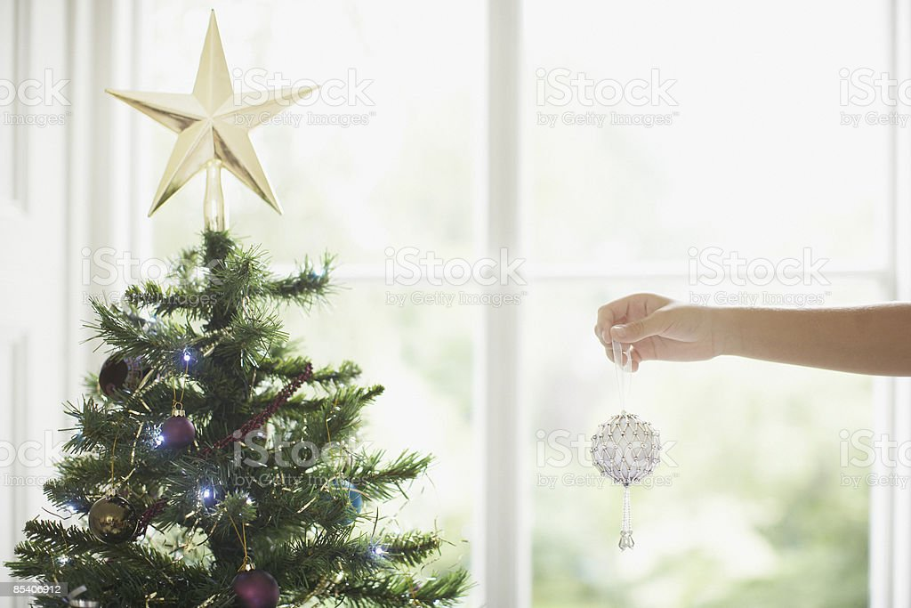Child decorating Christmas tree royalty-free stock photo