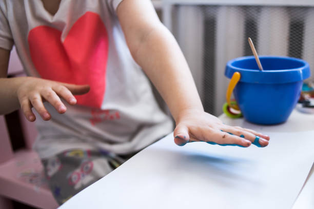 Child development creativity with paints in quarantine handprints picture id1226774741?b=1&k=6&m=1226774741&s=612x612&w=0&h=qxvp4jvflh ajykhobq6vwusnf ltzoayk5jpmwne8q=