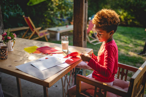 Child doing a art project at home stock photo