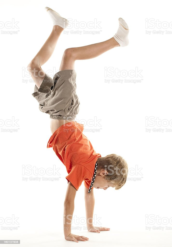Child Doing a Hand Stand stock photo