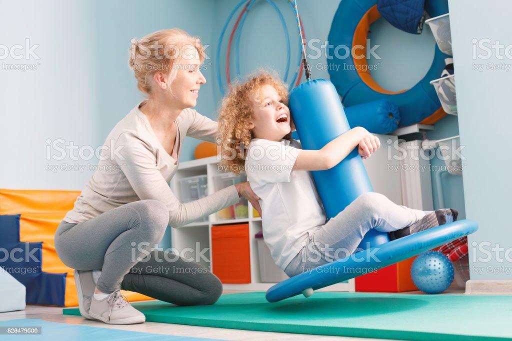 Child doing balance exercises stock photo
