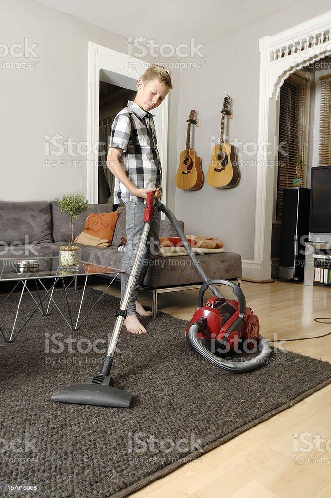 Child doing the vacuuming stock photo