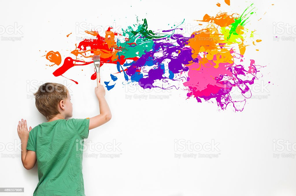 Child drawing an abstract picture stock photo