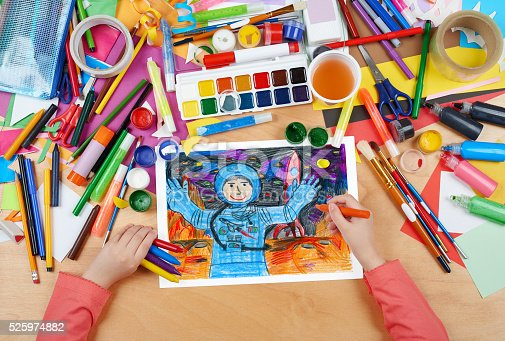 istock child drawing astronaut exploring the red planet, space concept 525974882