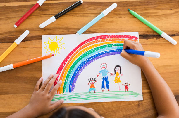 Child drawing happy family stock photo