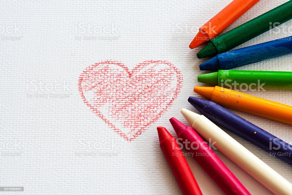 child drawing heart, drawing with pencil painting picture on paper stock photo