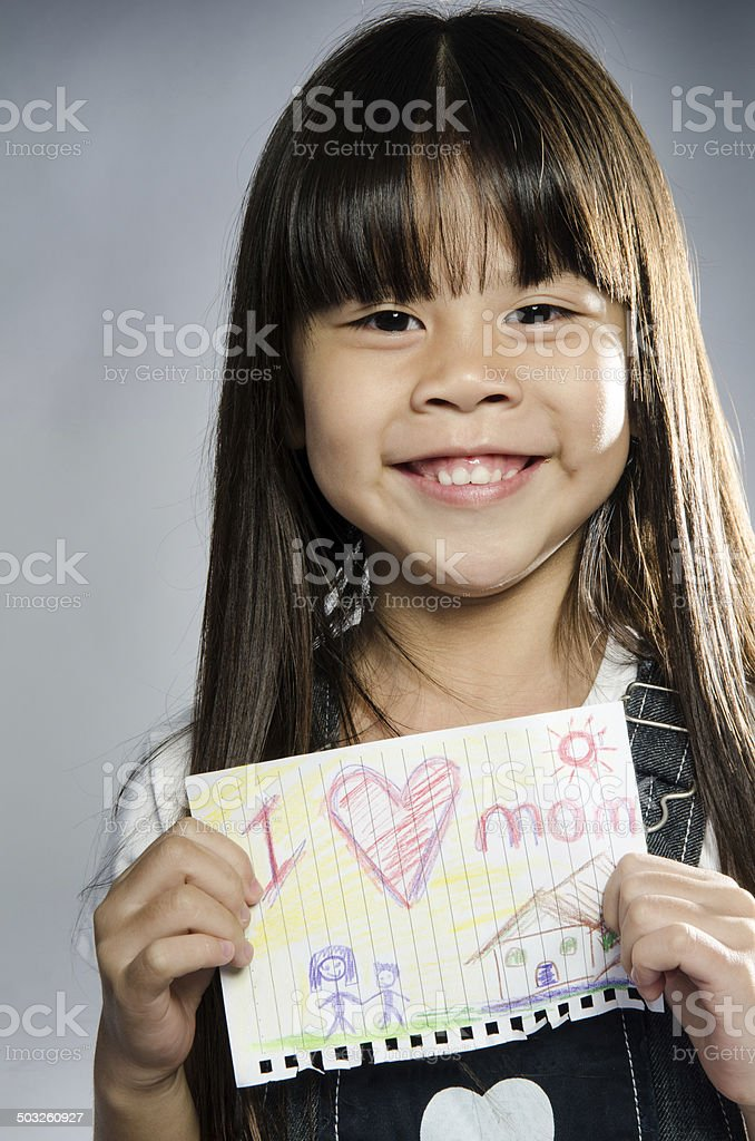 Child drawing of her mother for mother's day stock photo