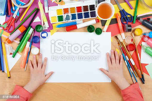 istock Child drawing top view. Artwork workplace with creative accessories. 518184954