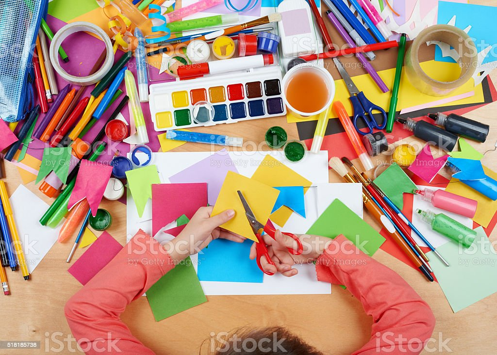 Child drawing top view. Artwork workplace with creative accessories. stock photo
